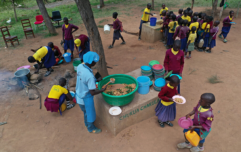 Chakula Chetu school meal distribution in Tanzania.